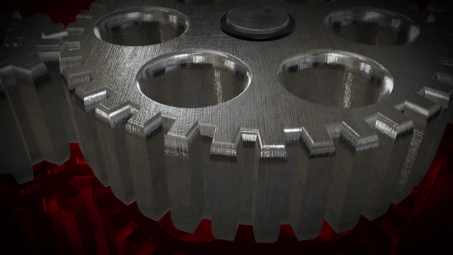 Close up view of animated rotating steel gears A close up view of animated rotating brushed steel cogs pn a red background with reflection created in After Effects brushed metal stock videos & royalty-free footage