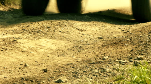Close up view of ATV wheels in terrain. video