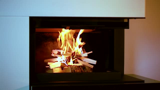 Close up view of burning wood in fireplace. Beautiful backgrounds. Close up view of burning wood in fireplace. Beautiful backgrounds. fireplace stock videos & royalty-free footage