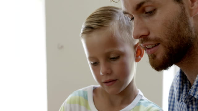 Close up view of father and son talking video