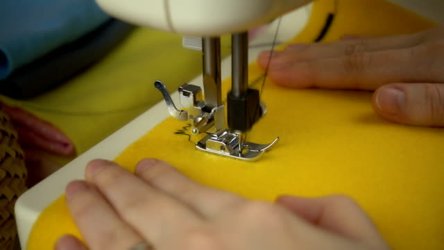 close up view of sewing process in slow motion - feltro video stock e b–roll