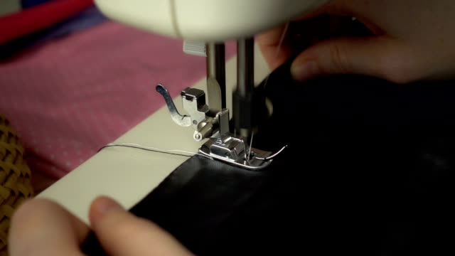 Close up view of sewing process in slow motion
