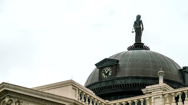 Close Up View of the Analog Clock On top of the Georgetown Court House With Cloudy Skies