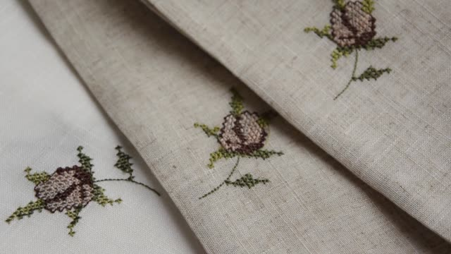 Close up view of the linen napkin with embroidery, piece of vintage calico Close up view of the linen napkin with embroidery, piece of vintage calico painting art product stock videos & royalty-free footage