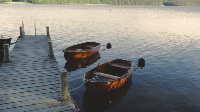 Close up view of two parked wooden boats. Beautiful nature backgrounds.