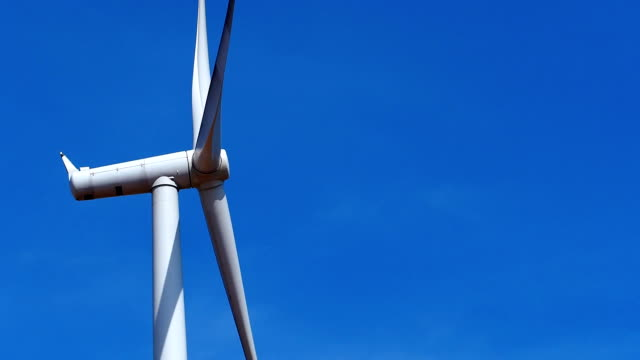 Close up wind turbines generating electricity video