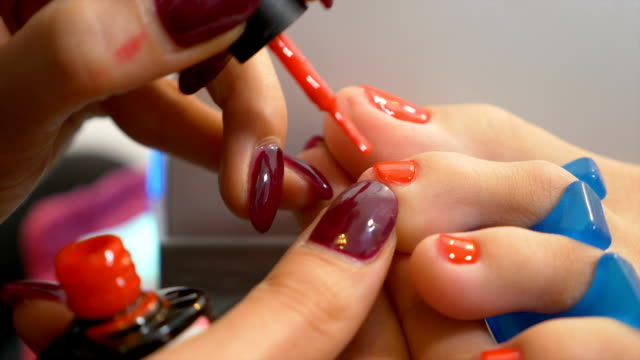 Close up with toe nails of woman getting semi permanent pedicure video