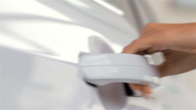Close up woman hand opening car door video