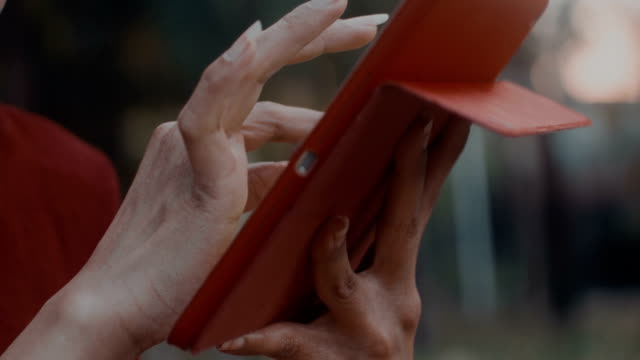 Close up woman hands using ipad video