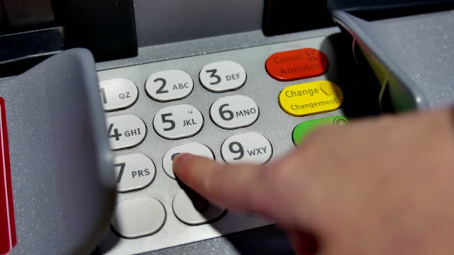 close up woman pressing password at atm machine - banks and atms stock videos & royalty-free footage