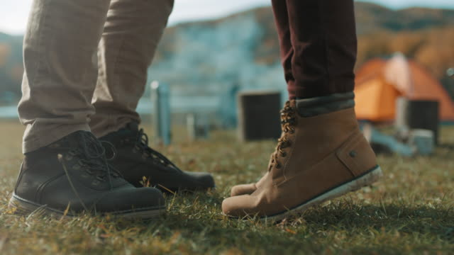 Close up, woman standing on her toes beside man Close up, woman standing on her toes beside man face to face stock videos & royalty-free footage