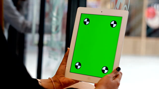 Close Up women using tablet  with green screen video