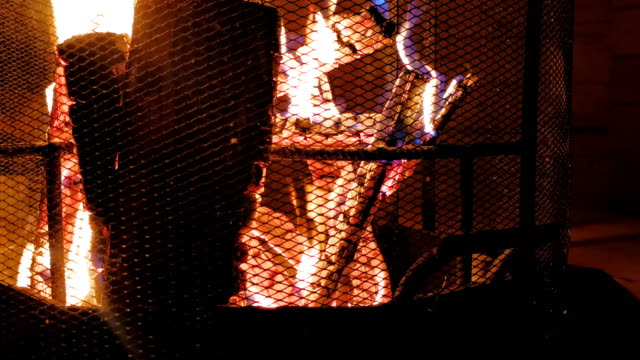 A close up wood burning fireplace in a tourist hut in the Carpathian mountains warms its tourists with warmth and comfort. Tourism in the mountains of the Carpathians, Ukraine. Prores 422