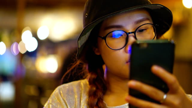 Close up Young Asian woman using mobile phone touchscreen. Slow motion : Close up Young Asian woman using mobile phone touchscreen. scandal abc stock videos & royalty-free footage
