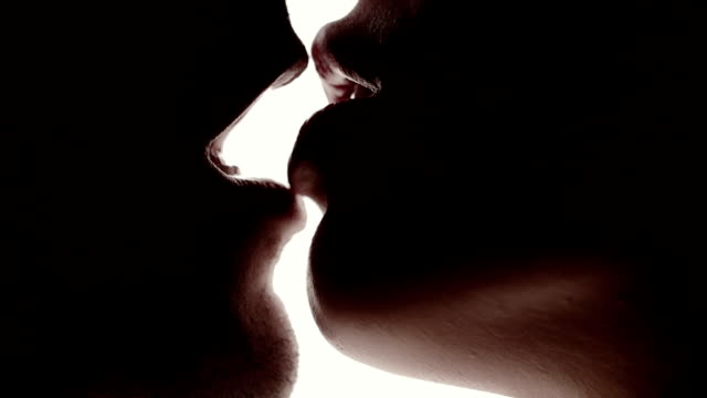 Close up young caucasian couple kissing  - love - lover Passionate dating a beautiful young couple in front of window sexual activity sex naked couple stock videos & royalty-free footage