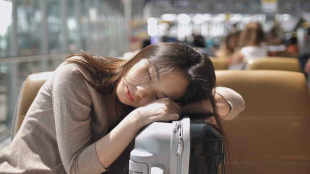 Close up Young woman Sleep At The Airport waiting for her flight video
