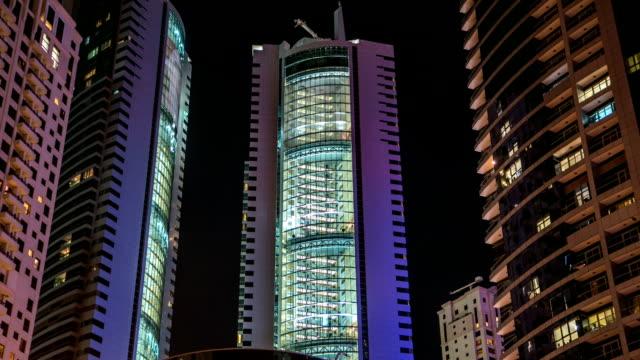 Close View of Dubai Marina Towers in Dubai at night timelapse video