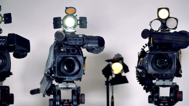 A close view on video cameras lenses and mikes. video