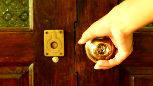close wooden modern door with one hand video