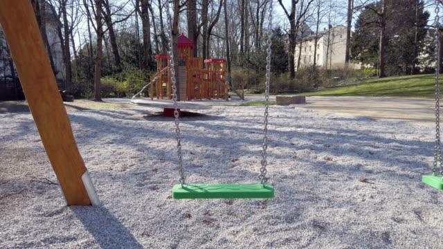 closed playground during coronavirus epidemic lockdown - ludzka osada filmów i materiałów b-roll
