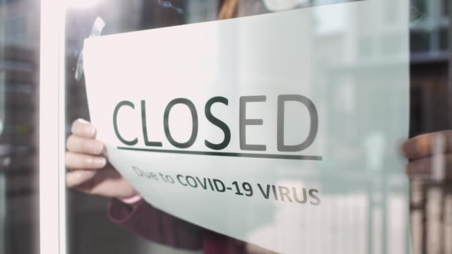 Closed sign on shop door Due to COVID-19 VIRUS, Slow motion