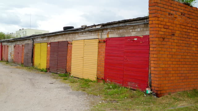 Closer look of the colorful gates of the wooden bunk houses