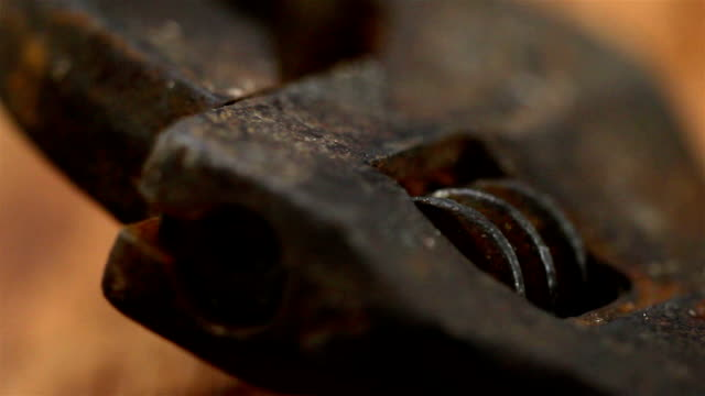 Closer look of the head of a pipe wrench video