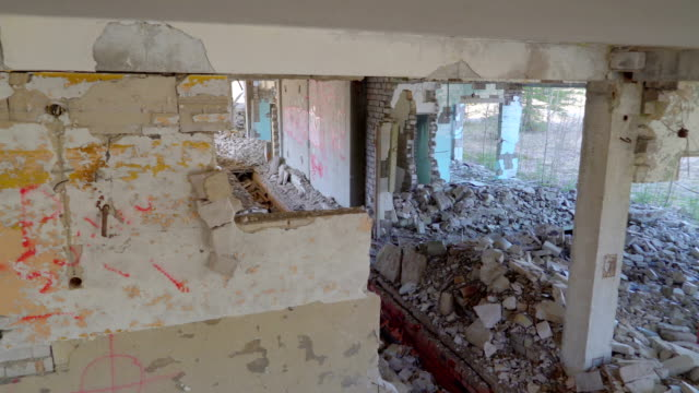 Closer look of the inside of the damaged house and property video