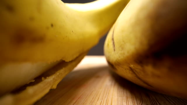 a closer look of the open banana fruit on the table - healthy green juice video stock e b–roll