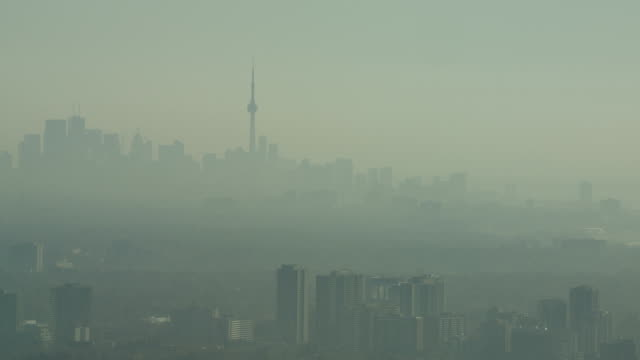 Closer shot of The Toronto Skyline in the early morning in late fall.  Hazy and a lot smoggy video