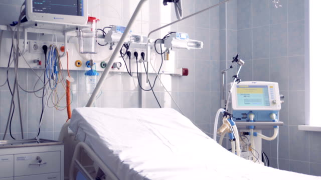 Closer view of a part of a hospital ward where the bed and other equipment are located