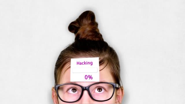 vídeos de stock, filmes e b-roll de close-up, um rosto adolescente inteligente, uma criança de óculos, com um adesivo na testa. uma animação do processo hacking ocorre no adesivo - validação