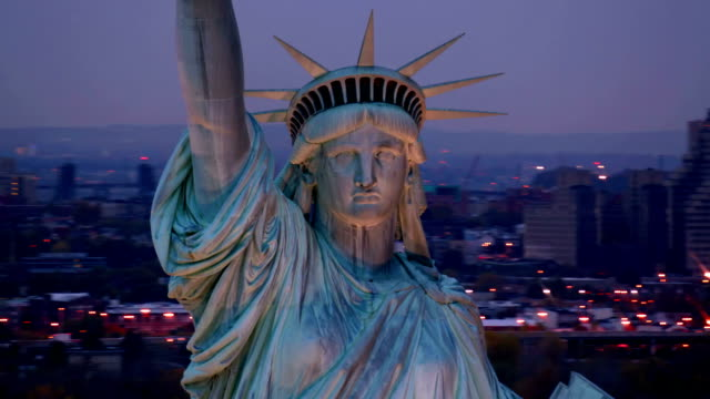 Closeup aerial shot, Statue of Liberty at dusk