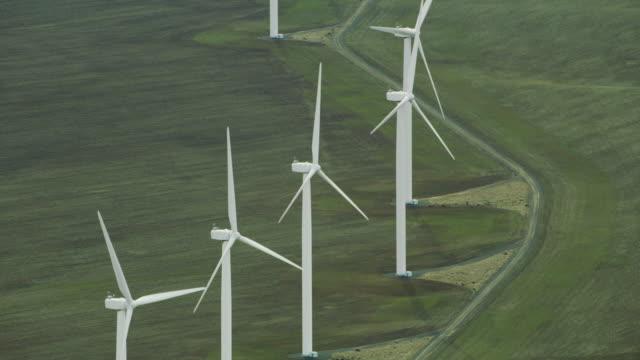 close-up aerial view of wind turbines - attrezzatura energetica video stock e b–roll