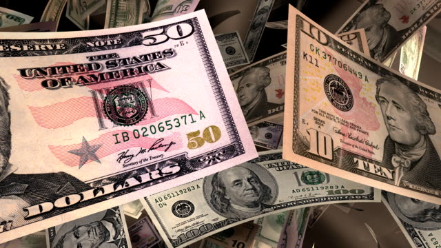 Close-up, American Currency Flying Through a Warm Light (Loop) video