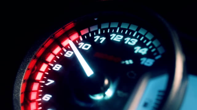 Close-up arrow speedometer of sports bike at high speed. Close-up arrow speedometer of sports bike at high speed. Motorcycle dashboard. Racing in the night city. Night rider. motorcycle stock videos & royalty-free footage