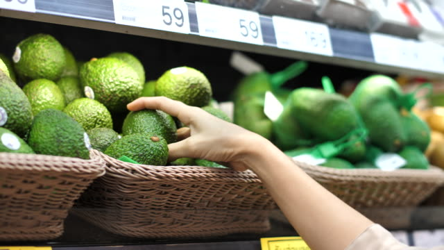 Close-up Asian Woman Avocado fruit Shopping in Supermarket Close-up Asian Woman Avocado fruit Shopping in Supermarket avocado stock videos & royalty-free footage