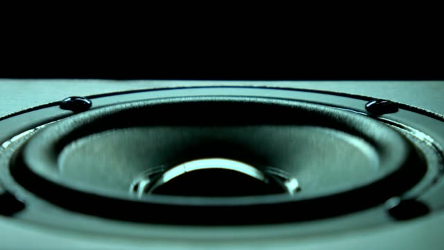 closeup at moving sub-woofer. speaker part music. background. - magnete video stock e b–roll