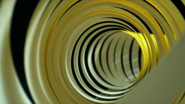 Close-up backward slide shot inside spiral paper tape. Abstract tunnel shot Close-up backward slide shot inside spiral paper tape. Abstract tunnel shot. Probe lens view twisted stock videos & royalty-free footage