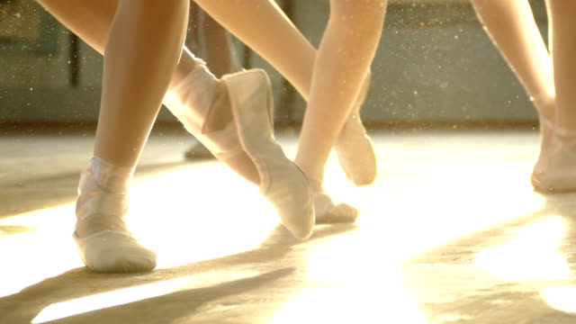 close-up - ballerinas feet in the rays of light video