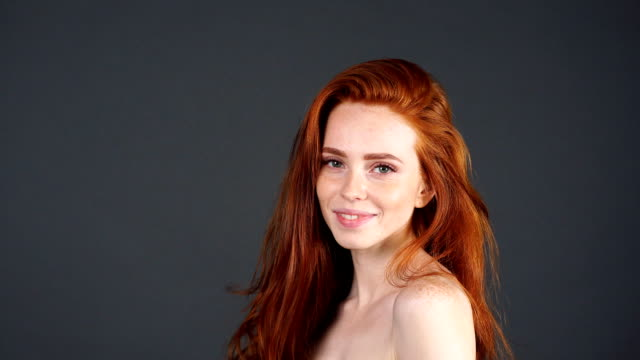 Closeup Beauty portrait of woman face with the red hair