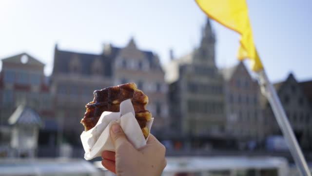 close-up belgium waffle in hand - belgio video stock e b–roll