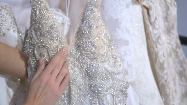 Close-up: bright elements of wedding dress video