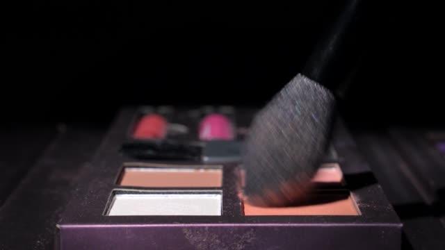 closeup brush macro dipped in makeup powder video