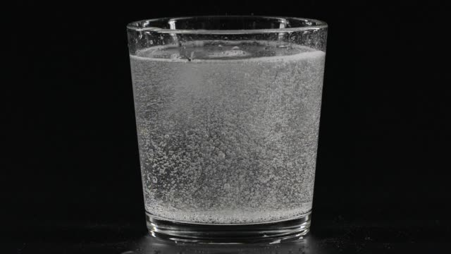 Close-up bubbles in a glass of soda water video
