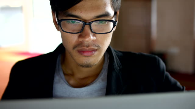 Close-up Business man working at a computer, 4K(UHD) 4k(UHD3840):Close-up Business man working at a computer, Apple ProRes 422 (HQ) 3840x2160 format university student stock videos & royalty-free footage