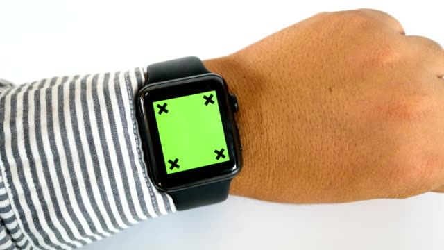 Close-up businessman using smart watch with green screen on white background, chroma key Close-up businessman using smart watch with green screen on white background, chroma key wristwatch stock videos & royalty-free footage