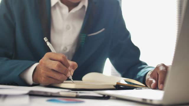 Close-up Businessman working on desk