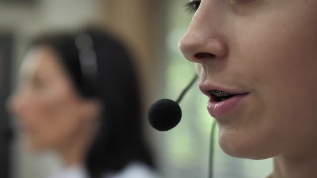 close-up call center agents working in their office - call centre stock videos & royalty-free footage