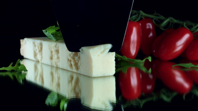 4K Close-up Cheese Parmesan with Cherry Tomatoes video